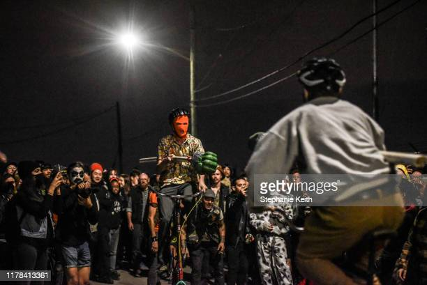 A person prepares to ride towards his opponent during a round of bike jousting during the annual Bike Kill event on October 26 2019 in New York City...