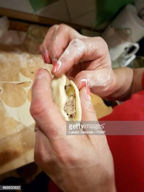 A person preparing pierogi