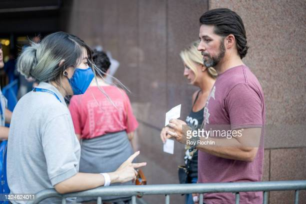 Person presents his proof of vaccination while standing in line for the Foo Fighters show as Madison Square Garden reopens with the first full...