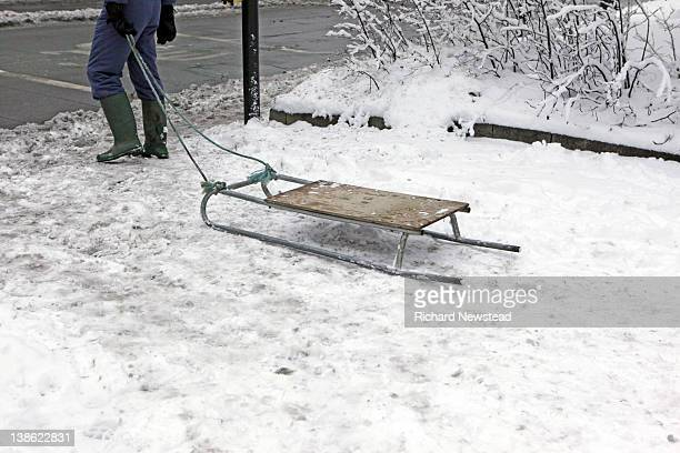 person pulling homemade sledge - 7894 stock pictures, royalty-free photos & images