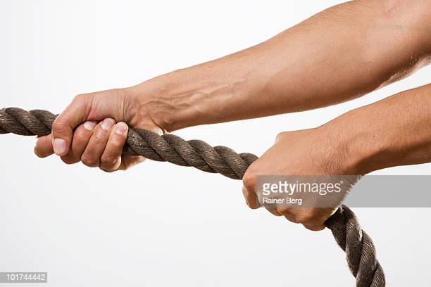 person pulling rope, close-up - rope stock pictures, royalty-free photos & images