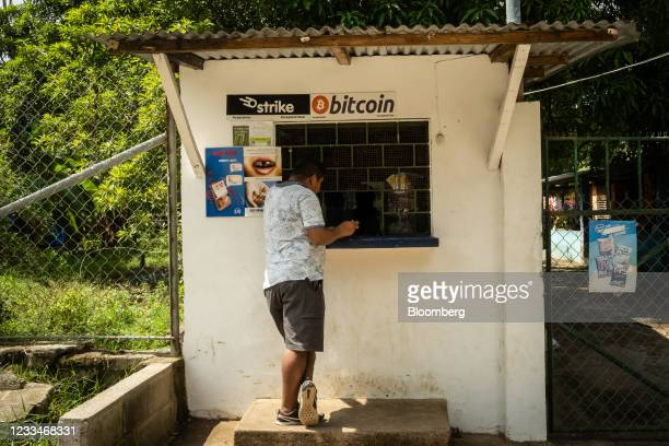 Person purchases a bottle of Coca-Cola from a shop that accepts Bitcoin in El Zonte, El Salvador, on Monday, June 14, 2021. El Salvador has become...