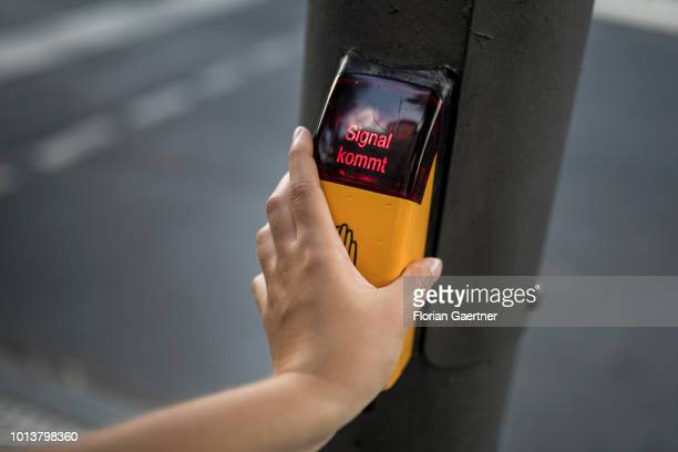 A person pushs the button for the pedestrian crossing on August 08 2018 in Berlin Germany