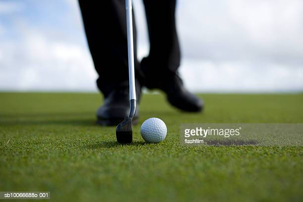 person putting golf ball, low section (differential focus) - putting stock pictures, royalty-free photos & images