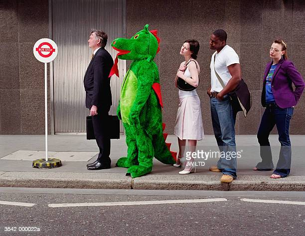 person queuing in fancy dress - standing out from the crowd stock pictures, royalty-free photos & images