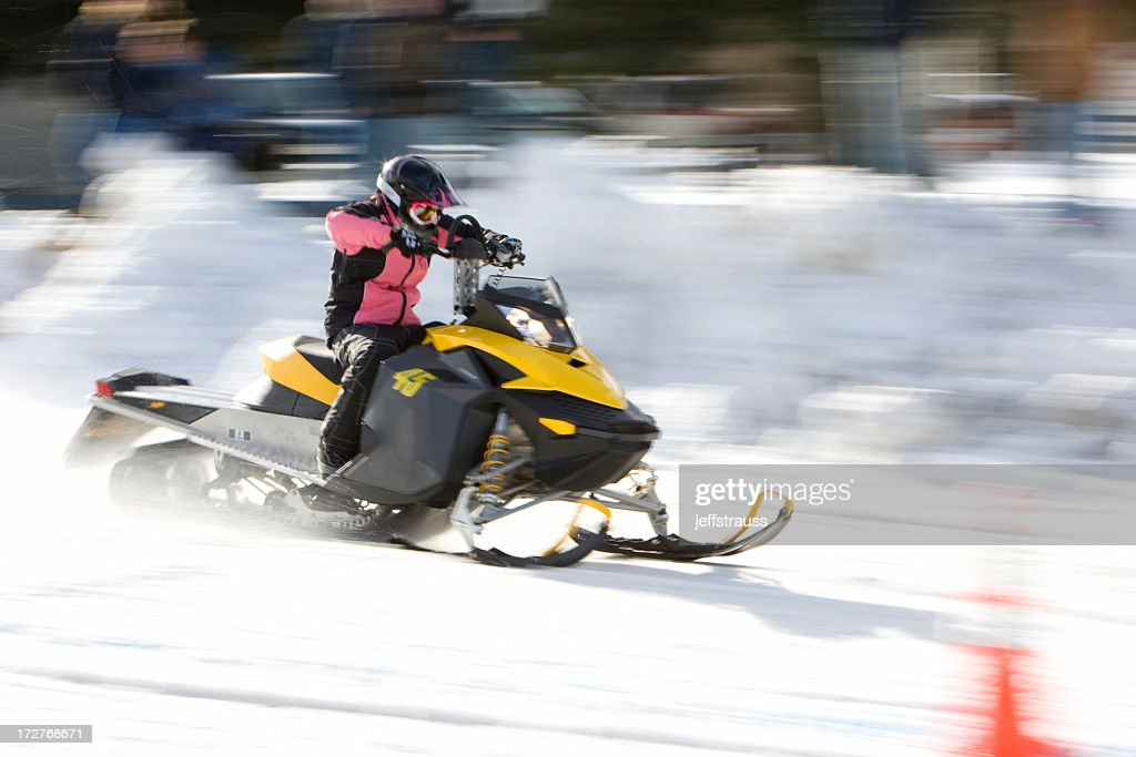 A Person Racing On A Snowmobile Stock Photo - Getty Images