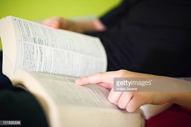 person reading dictionary - dictionary stock pictures, royalty-free photos & images