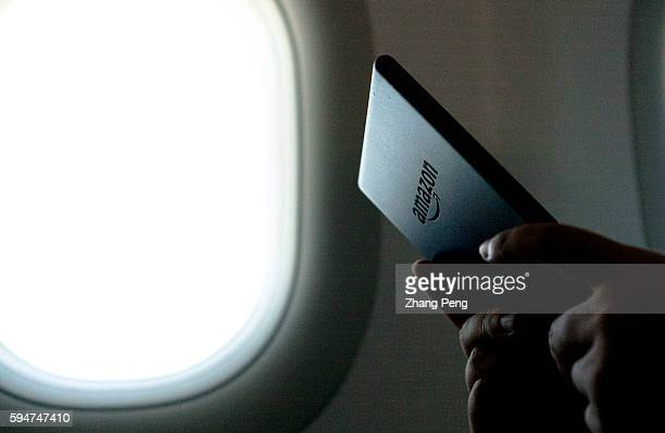 A person reads a kindle ebook on an airplane Amazon released a new entry level Kindle in the mid of 2016 Now Amazon has a whole and largest ebook...