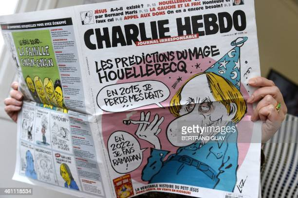 A person reads the latest issue of the French satirical newspaper Charlie Hebdo in Paris on January 7 after gunmen armed with Kalashnikovs and a...