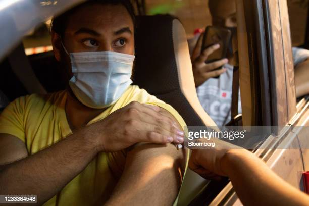 Person receives a Covid-19 vaccine at a drive-through vaccination center set up at the Gaddafi Stadium in Lahore, Pakistan, on Thursday, June 10,...