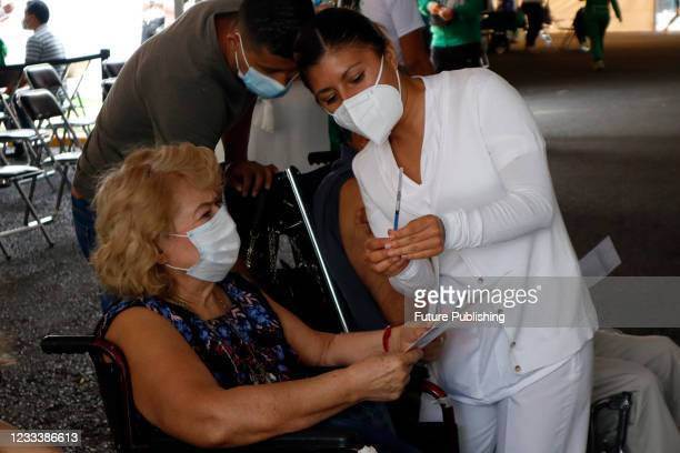 Person receives a Pfizer BioNTech dose during mass vaccination campaign for people of 40 to 49 years old to immunize against Covid-19 disease at...