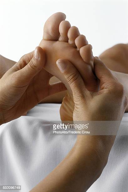 Person receiving foot massage, close-up