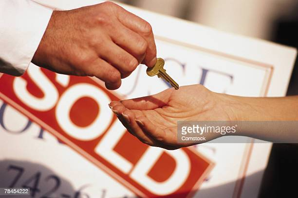 person receiving key to new home - sold single word stock pictures, royalty-free photos & images