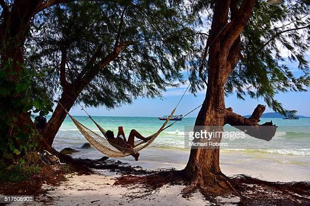 Person relaxing in hammock on Koh Rong island in Cambodia