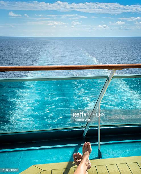 Person relaxing on a deck of a cruise ship