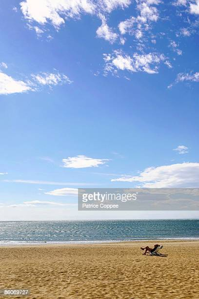 person relaxing on secluded beach, le cap d'agde, france - cap dagde stock pictures, royalty-free photos & images