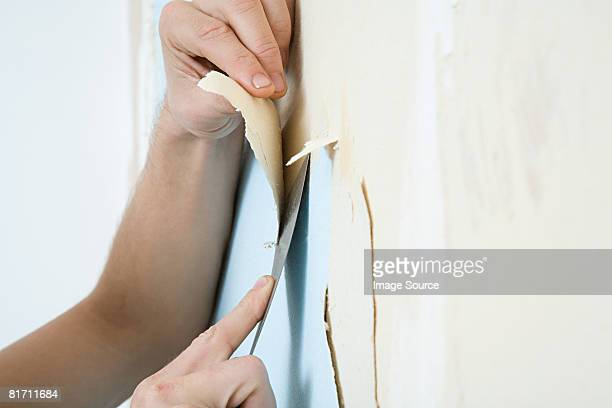person removing wallpaper - absence stock pictures, royalty-free photos & images