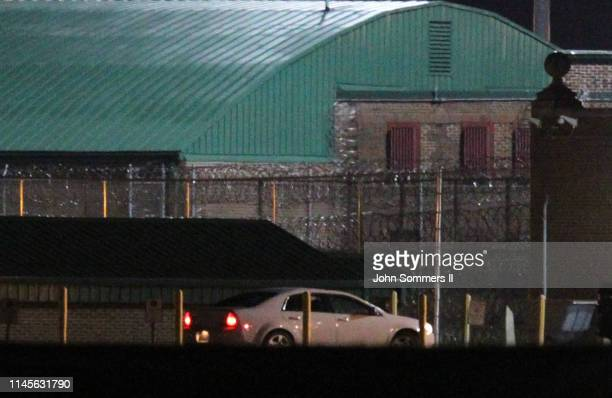 A person reportedly to be American Taliban John Walker Lindh is seen leaving the Terre Haute Federal Correctional Complex by a white car early in the...