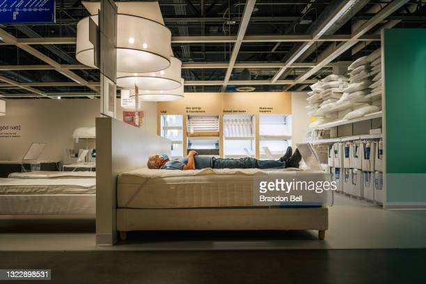 Person rests on a bed at an IKEA store on June 10, 2021 in Houston, Texas. The Labor Department reported that this May, consumer prices have...