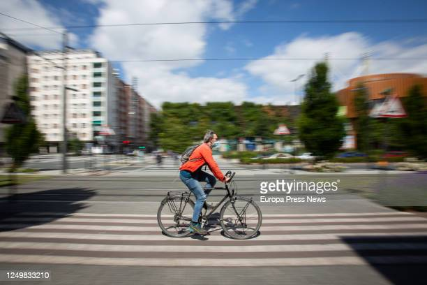 Person rides a bicycle during the 90th day of the state of alarm, when micro-mobility is becoming a sustainable solution in large cities in the...