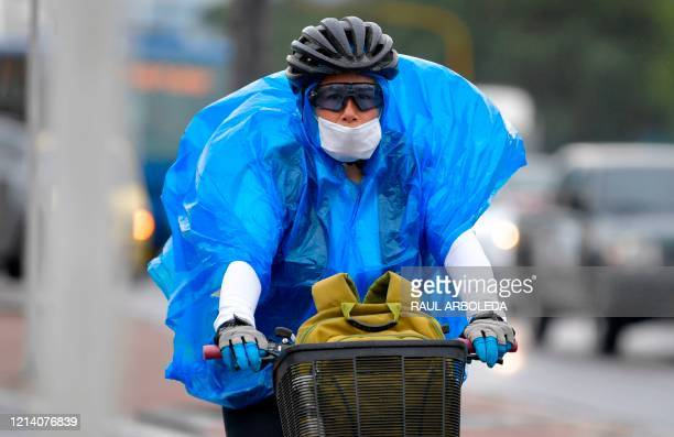A person rides a bicycle in Bogota on May 19 after the city's mayor expanded bicycle lanes temporarily during the COVID19 pandemic so people can...