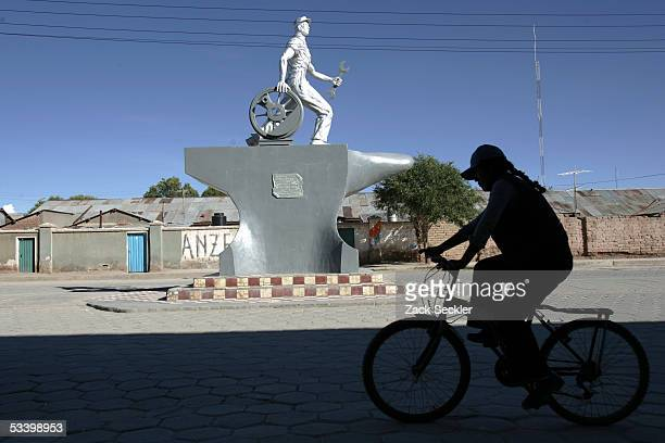 Person rides a bike down a main street in Uyuni, a town that serves as a base of tours to the Salar de Uyuni, January 28, 2005 in Bolivia. Bolivia's...