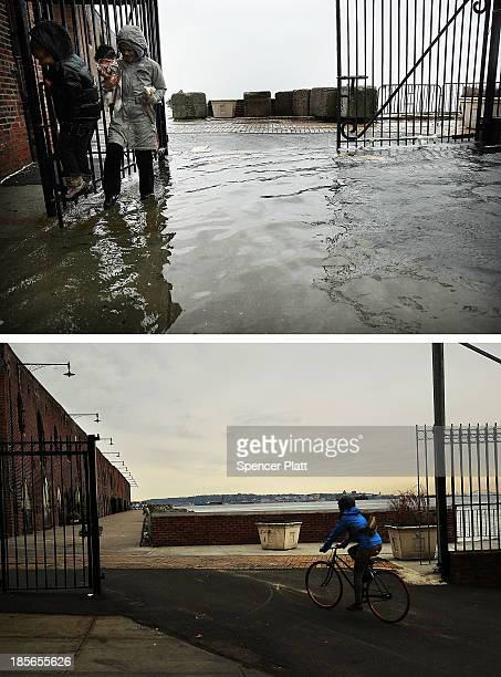 A woman and child walk through water on a flooded street as Hurricane Sandy moved closer to the area on October 29 2012 in the Red Hook section of...