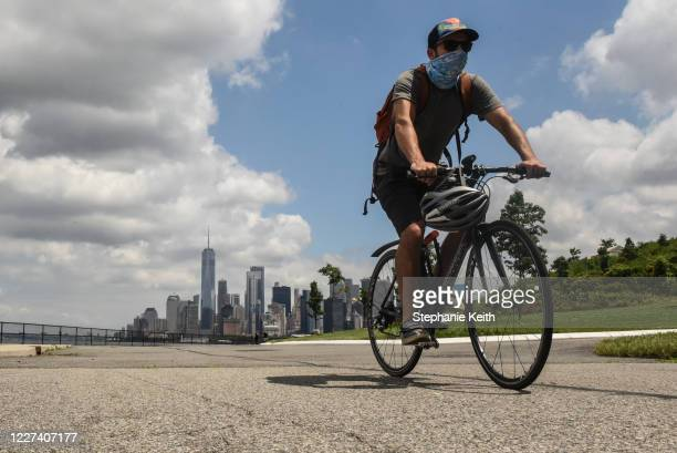 Person rides a bike on Governors Island on July 15, 2020 in New York City. Governors Island reopens to visitors on Wednesday with limited capacity...