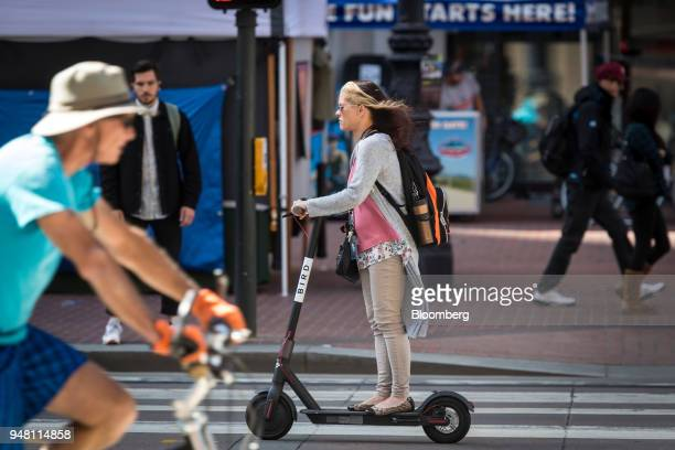A person rides a Bird Rides Inc shared electric scooter in San Francisco California US on Friday April 13 2018 GPSenabledscootersand bicycles are...