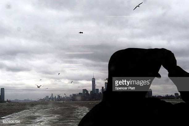 A person rides the Staten Island Ferry as Manhattan sits under heavy cloud cover as the city prepares for a nor'easter storm on January 23 2017 in...