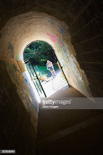 person riding a bicycle viewed through an archway, pont yssoir, le mans, sarthe, france - sarthe stock pictures, royalty-free photos & images