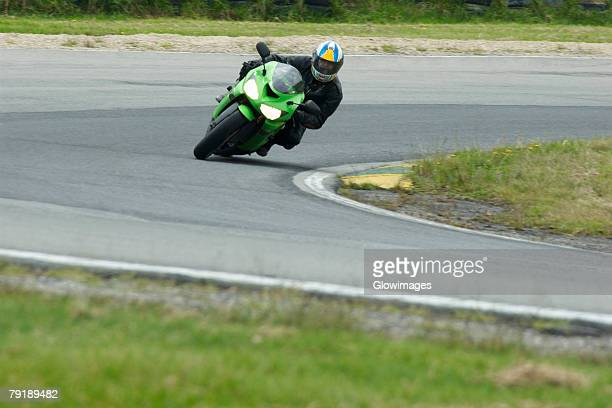 Person riding a motorcycle on a motor racing track