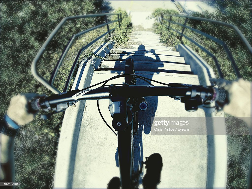 Person Riding Bicycle On Steps : Stock Photo