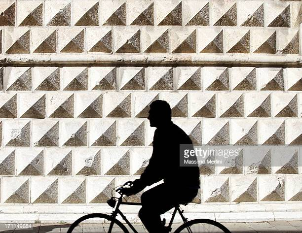 person riding bicycle - ferrara stock pictures, royalty-free photos & images