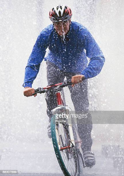 Person riding bicycle through rain
