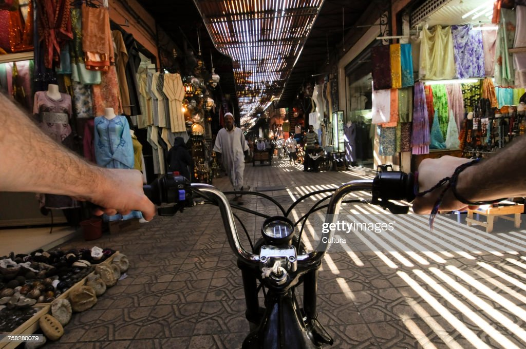 Person Riding Bike In Street Market Medina Marrakech Morocco Stock ... d608bb5d9