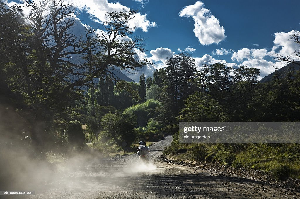Person riding bike on dirt track : Foto stock
