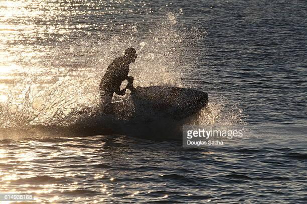 Person Riding Jet Ski In Sea