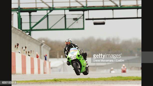 Person Riding Motorcycle At Race