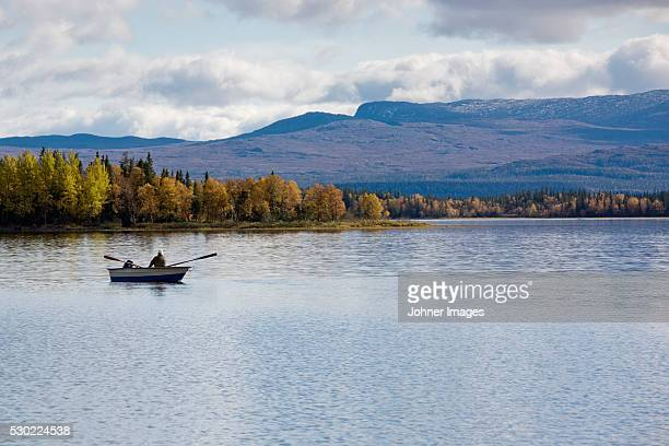 Person rowing on lake