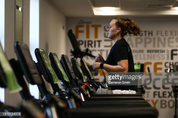 Person runs on a treadmill at Falmouth University, Penryn Campus Sports Centre on April 12, 2021 in Penryn, England. England has taken a significant...