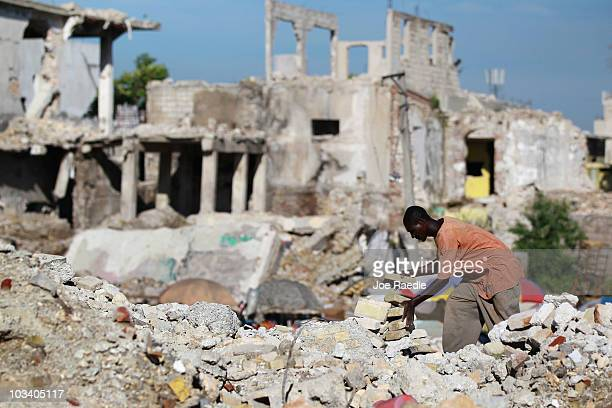 A person salvages bricks from a building that collapsed during the January 12th earthquake on August 16 2010 in PortauPrince Haiti As the country...