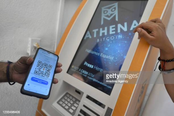 Person scans a QR code at a bitcoin atm on June 16, 2021 in Chiltuipan, El Salvador. Playa El Zonte has been named as the Bitcoins capital, around...