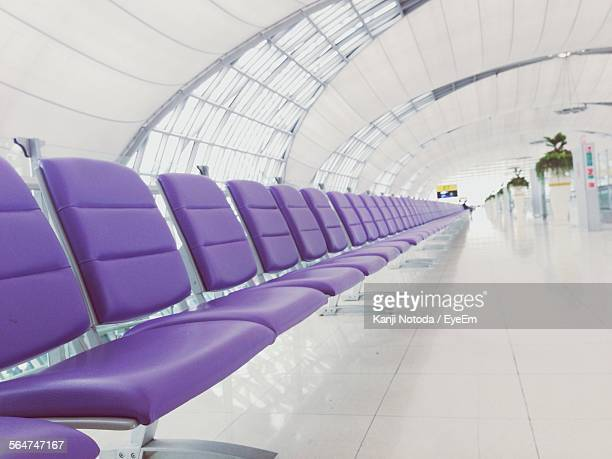 Person Seen At Distant On Seat Of Airport Lobby
