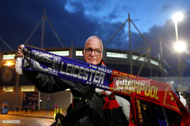 A person selling club merchandise outside the stadium wears a mask of former Leicester City Manager Claudio Ranieri prior to the Premier League match...