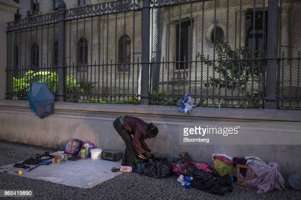 A person sells found items on a street in Rio de Janeiro Brazil on Thursday Aug 24 2017 According to the World Bank Brazil's economic and social...