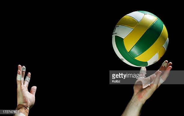 person serving a volleyball on a black background - serving sport stock pictures, royalty-free photos & images
