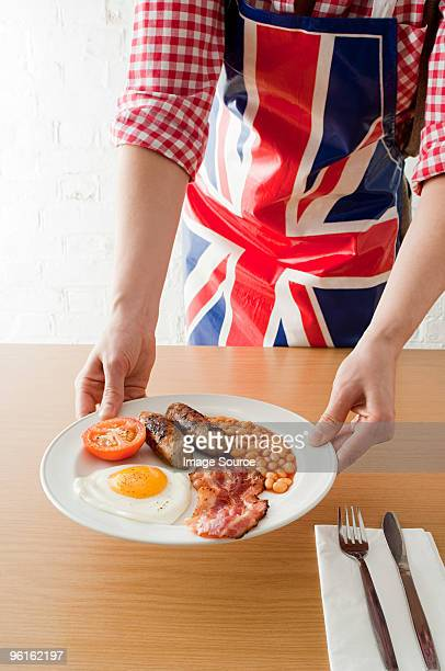 Person serving english breakfast