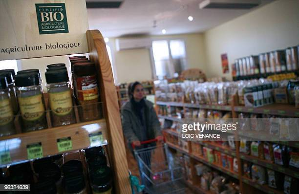 A person shops in a Bio supermarket on January 11 2010 in MontdeMarsan southwestern France AFP PHOTO LOIC VENANCE