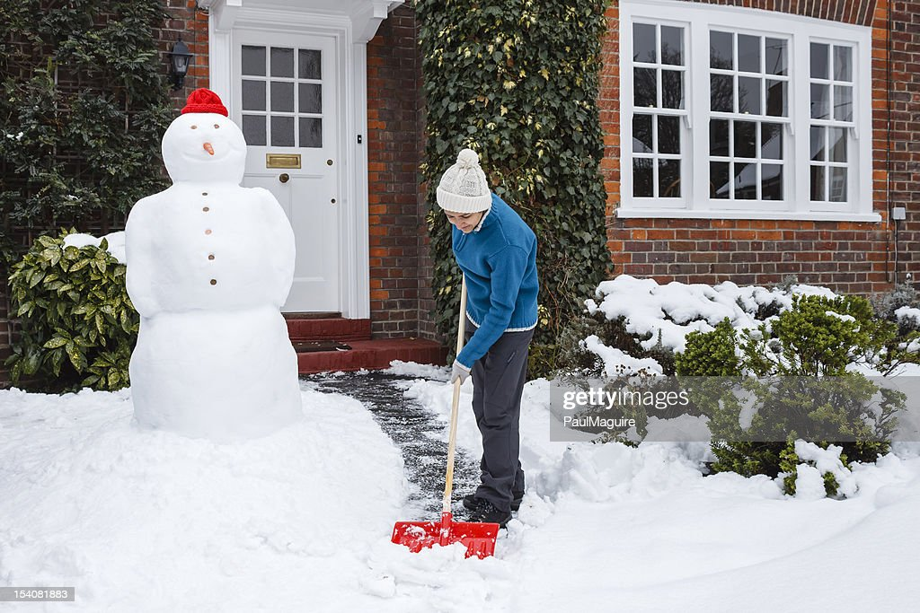Person shoveling snow : Stock Photo
